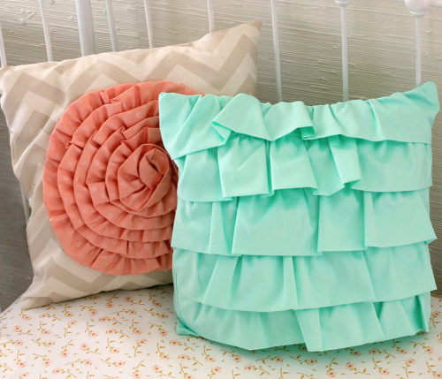 mint-layered-ruffle-pillow-and-coral-dot-rosette